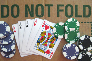 "A poker hand on a box that reads ""Do Not Fold"""